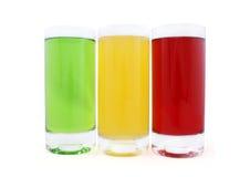 Tres vidrios con el jugo coloreado imagen de archivo libre de regalías