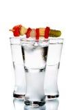 Tres vidrios con la vodka Foto de archivo