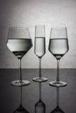 Tres vidrios de agua Imágenes de archivo libres de regalías