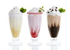 Tres vidrios de batidos de leche imagen de archivo libre de regalías