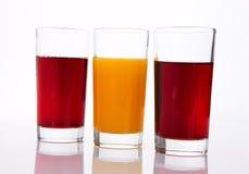 Tres vidrios de jugo Imagenes de archivo