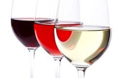 Tres vidrios de vino aislados en blanco Fotos de archivo libres de regalías
