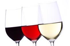 Tres vidrios de vino aislados en blanco Imagenes de archivo