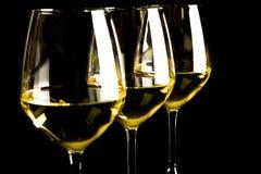 Tres vidrios de vino blanco Foto de archivo libre de regalías