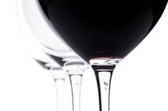 Tres vidrios de vino con el vino rojo Foto de archivo libre de regalías