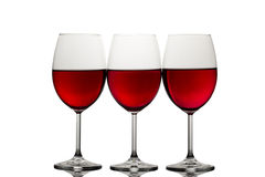 Tres vidrios de vino con el vino rojo Fotos de archivo libres de regalías
