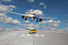 Treshold of runway with car and plane Stock Images