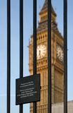 Trespass sign and Big Ben. Exterior of Big Ben clock tower on Palace of Westminster with bars and trespass warning notice in foreground, London, England Stock Images