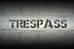 Trespass word gr. Trespass stencil print on the grunge white brick wall royalty free stock photography