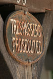 Trespassers Prosecuted Sign. A Do Not Trespass sign posted on a barn Stock Photo