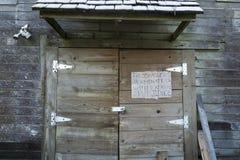 Trespassers terminated with extreme prejudice. Sign on old building - trespassers terminated with extreme prejudice - warns intruders away Royalty Free Stock Image