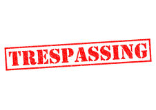 TRESPASSING. Red Rubber Stamp over a white background Stock Images