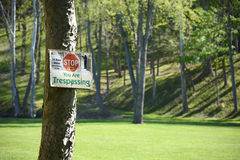 Trespassing. A well kept meadow with a now trespassing sign to keep hunters out Royalty Free Stock Photo