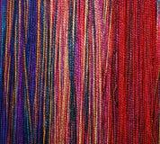 Tresses colorées d'amorçage de laines Photographie stock