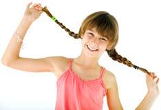Tresses heureuses de fille Photographie stock libre de droits