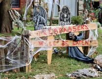 Tresspassers will be eaten sign in Halloween decorated yard stock image