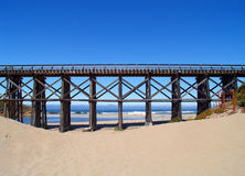 Trestle bridge. Cutting across the beach in Fort Bragg, CA Royalty Free Stock Image
