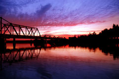 Trestle Bridge over River. Trestle Bridge and Trees Reflected at Sunset on San Joaquin River, Central Valley, California Stock Photos