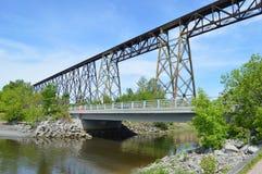 Trestle in Canada, iron bridge over a river. Trestle, iron bridge, tracel of Cap-Rouge, Quebec, Canada. Cap-Rouge river, trains, bridge over the river Stock Photo