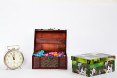 Tresure box full of colorful bonbons with a clock showing the la. St five minutes and a present box with pictures of cats Royalty Free Stock Image