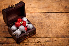 Tresure chest with Christmas decorations. On wooden table Royalty Free Stock Photography