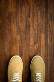 Trevelaing sneakers on wooden background Stock Photos
