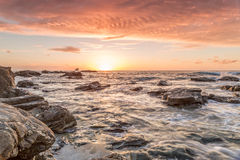 Trevellas porth sunset looking towards trevaunance coves in cornwall england uk Royalty Free Stock Photos