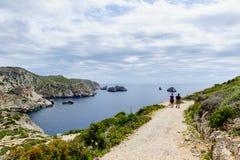 Treveller's couple walking. Mediterranean islands royalty free stock photos