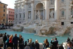 Trevi Fountain, landmark, ancient rome, tourism, plaza. Trevi Fountain is landmark, plaza and water feature. That marvel has ancient rome, human settlement and Stock Image