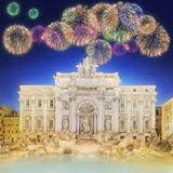 Trevi Fountain at night with beautiful fireworks Stock Images