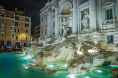 The Trevi Fountain. Night view of the Trevi Fountain, the largest baroque fountain in Rome, Italy. It is a popular tourist destination for millions of people Stock Image