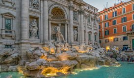 Trevi Fountain in Rome, Italy, at dusk with tourists Stock Photography