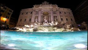 Trevi fountain, Rome, Italy. ROME, ITALY - MARCH 14, 2016: Tourists visiting and posing in the front of the Trevi fountain (Fontana di Trevi), one of the major stock video footage