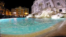 Trevi fountain, Rome, Italy. ROME, ITALY - MARCH 14, 2016: Tourists visiting and posing in the front of the Trevi fountain (Fontana di Trevi), one of the major stock footage