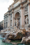 The Trevi fountain in Rome, Italy. The scene of The Trevi fountain, a large statue of Ocean who drives a chariot shape of a shell pulled by two winged horses, in Stock Photos