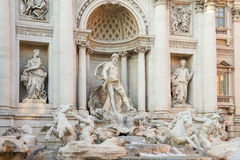 The Trevi fountain in Rome, Italy. The scene of The Trevi fountain, a large statue of Ocean who drives a chariot shape of a shell pulled by two winged horses, in Royalty Free Stock Photography