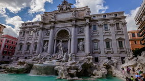 Trevi Fountain Rome. Daily time lapse in 4K: tourists and people walking next to the Trevi Fountain in a sunny day with clouds, one of the most famous fountain stock video