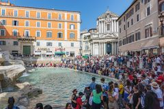 Trevi Fountain and Saints Vincent and Anastasius churchs - Rome, Italy royalty free stock photography