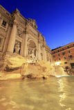 Trevi Fountain at Sunrise. Historic Trevi Fountain glows as the morning sky begins to brighten in Rome, Italy Stock Photos