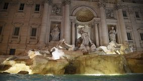 Trevi Fountain surrounded by tourists, evening shooting. Trevi Fountain surrounded by tourists, in the evening shooting in Rome stock footage