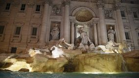 Trevi Fountain surrounded by tourists, evening shooting. Trevi Fountain surrounded by tourists, in the evening shooting in Rome stock video