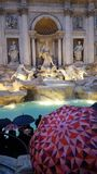 Trevi Fountain, tourist attraction, temple, building, umbrella. Trevi Fountain is tourist attraction, umbrella and shield, buckler. That marvel has temple royalty free stock photo