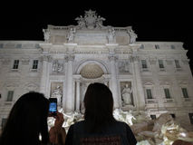 Trevi fountain with tourists Stock Photography