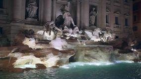 Trevi Fountain, waterfall. The famous Trevi Fountain seen from the front. Video taken in the evening, to articulate the waterfall, no people stock footage