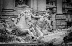 Trevi foutain. One of the two tritons carrying Ocean on his triumphal chariot Royalty Free Stock Photos
