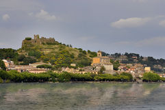 Trevignano Romano with ruined Orsini castle in the top. royalty free stock photography