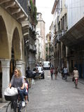 Treviso city centre with people riding a bike Stock Images
