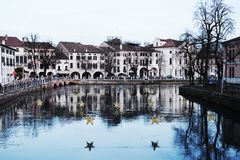 Treviso city and river during Christmas, Italy. Vintage hues Royalty Free Stock Photo