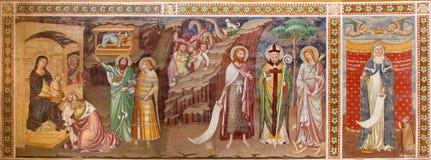 TREVISO, ITALIA - 18 MARZO 2014: Affresco di adorazione del Re Magi e di St Margaret 1370 a San Nicola o la chiesa di San Nicolo Fotografia Stock
