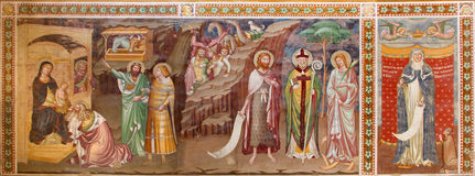 TREVISO, ITALY - MARCH 18, 2014: Fresco of Adoration of Magi and st. Margaret 1370 in saint Nicholas or San Nicolo church.  Stock Photo